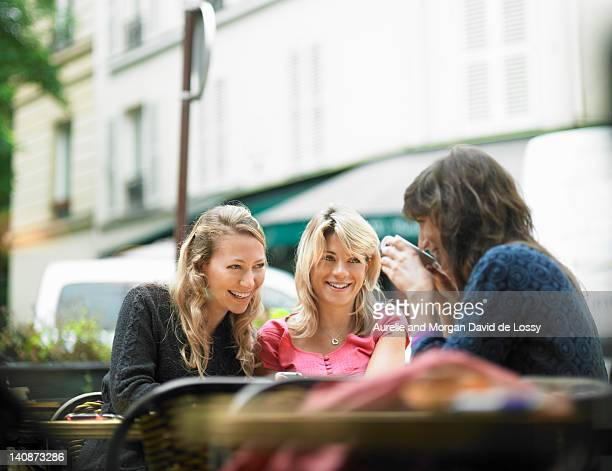 Women having coffee at sidewalk cafe