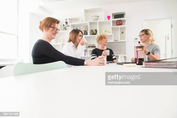 Women having coffee break in office