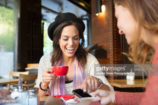 Women having coffee in cafe