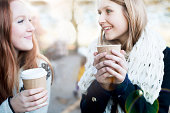Women having coffee together outdoors