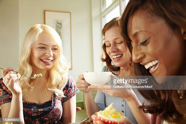 Women having dessert together in cafe