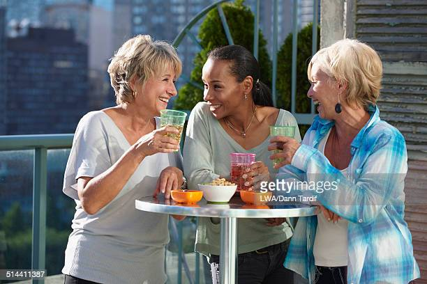 Women having drinks together at rooftop bar