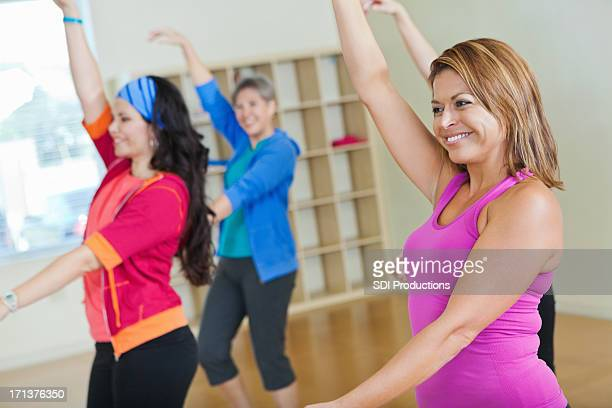 Women having fun in fitness exercise class