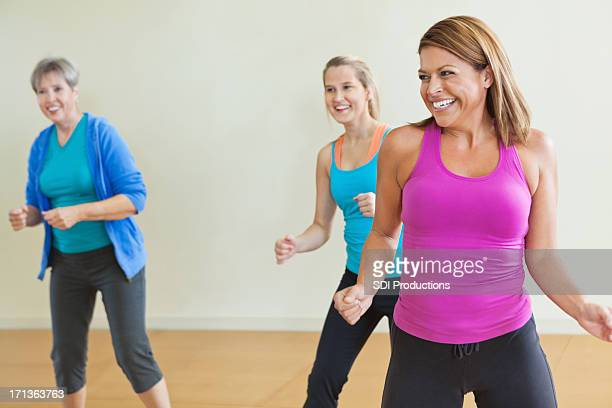 Women having fun together in fitness exercise class
