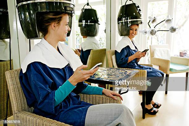 Women having hair done in salon