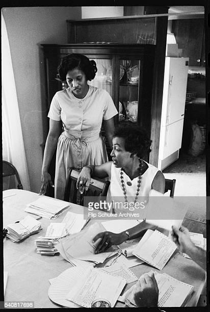 Women help Myrlie Evers sort through the telegrams of condolences after her husband Medgar was assassinated