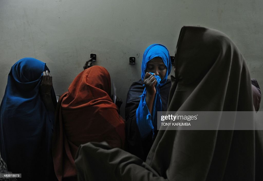 Women hide their faces as they wait in line to be vetted at a temporary centre on April 9, 2014 in Nairobi. Dozens of Somalis have been expelled from Kenya, officials said on April 9, as security forces maintained a major crackdown on suspected Islamists that has seen thousands rounded up in the country. Kenya's Interior Minister Joseph Ole Lenku said 3,000 people have so far been detained in the operation, and 82 of them flown back to Somalia's Mogadishu. He said hundreds more were still undergoing identity checks.