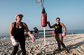 Women hit a sandbag near a beach boxing ring at Pepe beach in Rio de Janeiro Brazil on July 26 2016 Since boxing trainer Moacyr Lima first installed...