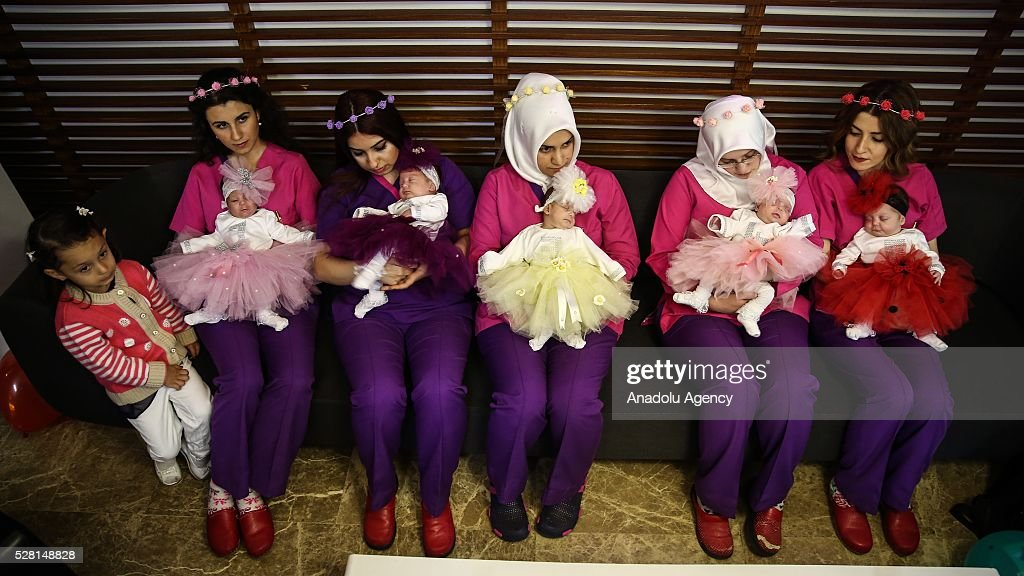 Women hold 83 days old quintuplet babies, who were born in the 28th week of the pregnancy, after the babies were discharged from the hospital in Bursa, Turkey on May 4, 2016. Quintuplets occur naturally in 1 in 55,000,000 births.