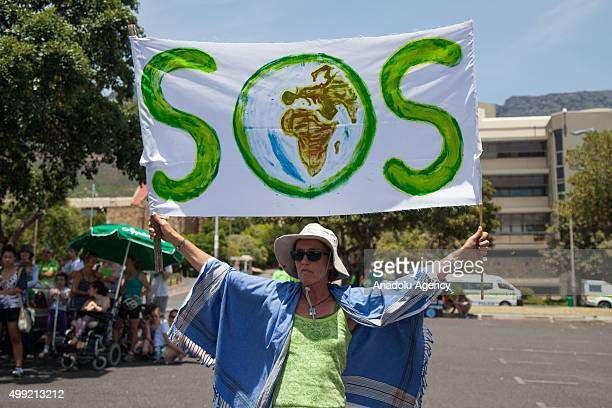 A women hold a banner as others march at Keizergracht Street during a protest against the 'Climate Change and Global Warming' in Cape Town South...
