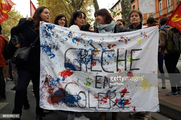 women hold a banner reading 'Angered childcare centre' Nearly 3000 protesters took to the streets of Toulouse France on October 19th 2017 against the...