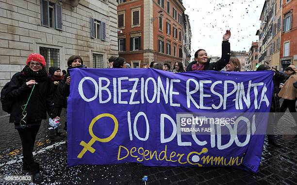 Women hold a banner reading ''I decide'' during a demonstration in central Rome against a reform of the Spain's abortion law proposed by the...