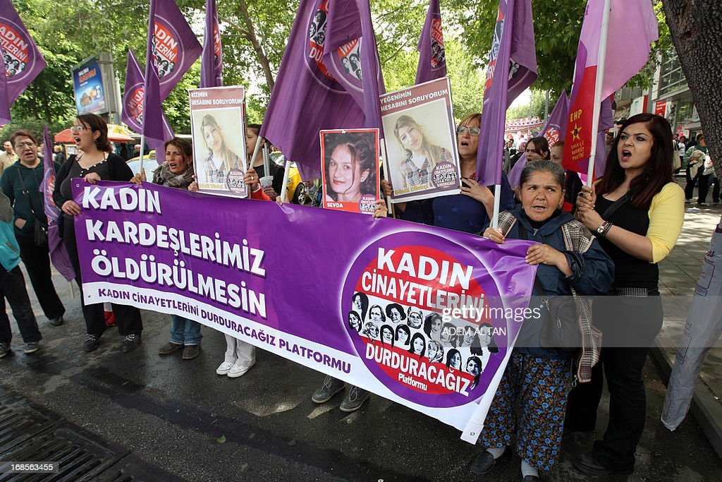 Women hold a banner reading 'Stop Killing Women' and pictures of women killed during a protest to denounce violence against women in Turkey on May 11, 2013 in Ankara. At least 26 women and three children have been killed in Turkey as a result of domestic violence during the first two months of 2013, officials said on March 16, 2013.