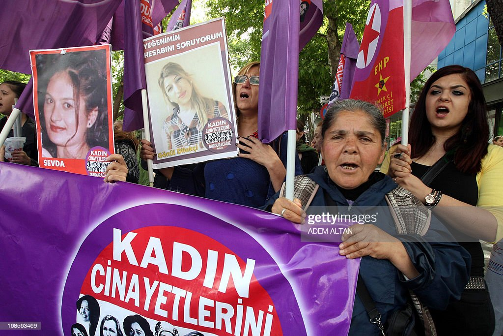 Women hold a banner reading 'Stop Killing Women' and pictures of women killed during a protest to denounce violence against women in Turkey on May 11, 2013 in Ankara. At least 26 women and three children have been killed in Turkey as a result of domestic violence during the first two months of 2013, officials said on March 16, 2013. AFP PHOTO / ADEM ALTAN
