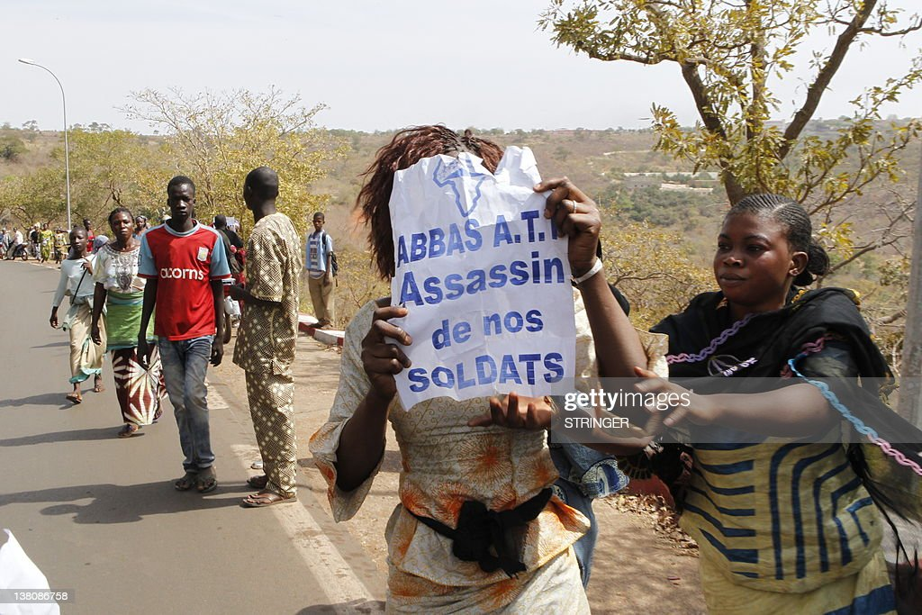 Women hold a placard reading 'A.T.T (Amadou Toumani Toure) Assassin of our Soldiers' during a protest of relatives and supporters of soldiers fighting rebels Tuareg in the north against the 'weak' response to attacks by the rebels, in Bamako on February 2, 2012. Malian President Amadou Toumani Toure has urged citizens not to attack civilian Tuareg, after retaliatory attacks on the community following the resumption of the Tuareg rebellion. Homes and property of Tuareg citizens have been vandalised in the towns of Segou (240 kilometres, 150 miles) from Bamako, and Kati, which is not far from the capital.