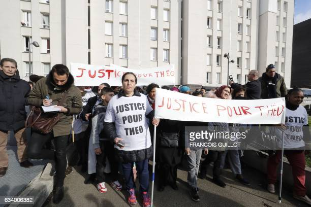 Women hold a sign reading 'Justice for Theo' during a protest on February 6 2017 in AulnaysousBois northern Paris a day after a French police officer...