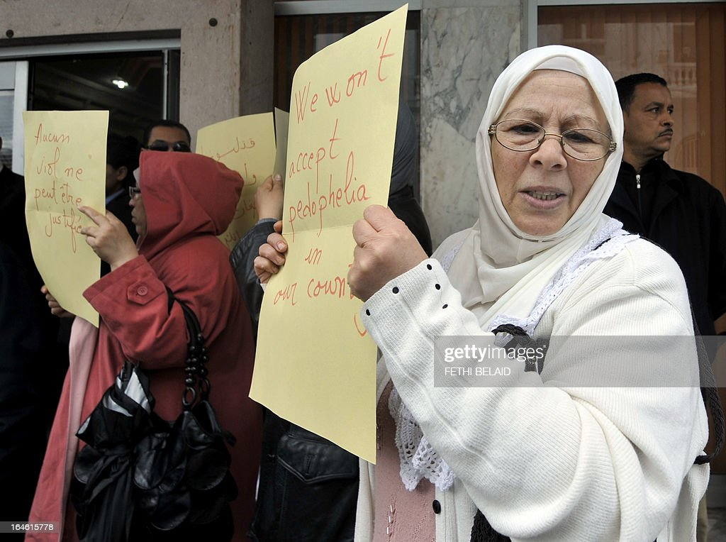 Women hold placards during a demonstration to demand the resignation of Tunisian Minister of Women's Affairs, Sihem Badi, outside the ministry on March 25, 2013 in Tunis. Protesters accuse her of having defended a kindergarten in a Tunis suburb where a three-year-old girl has been raped several times by a watchman.