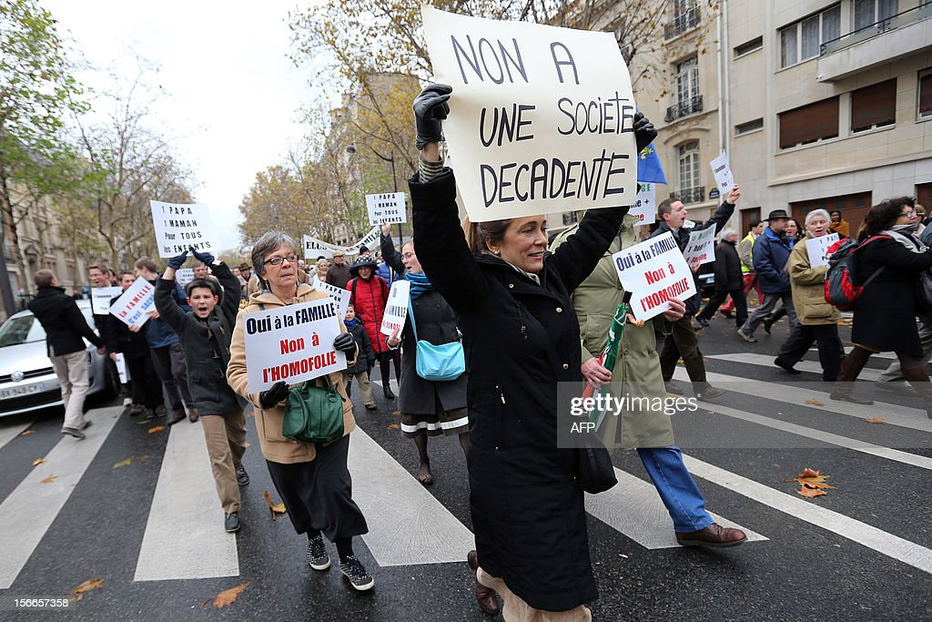 Women hold placards during a protest organized by fundamentalist Christians group Civitas Institute against the same-sex marriage on November 18, 2012 in Paris. France's Socialist government on November 7, 2012 adopted a draft law to authorise gay marriage and adoption despite fierce opposition from the Roman Catholic Church and the right-wing opposition. AFP PHOTO THOMAS SAMSON