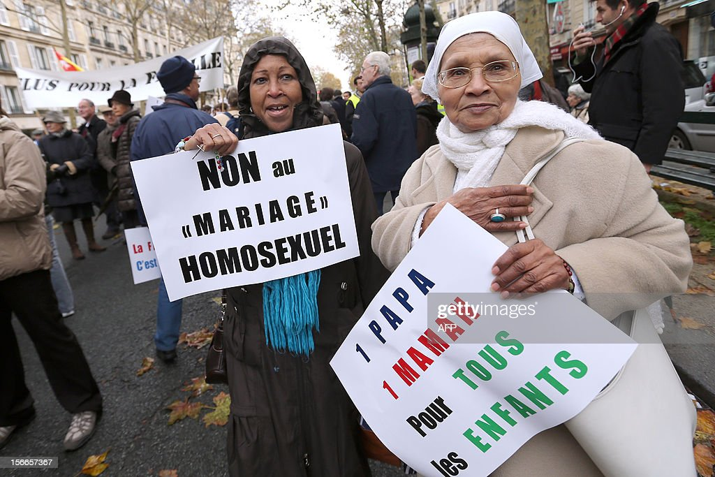 Women hold placards during a protest organized by fundamentalist Christians group Civitas Institute against the same-sex marriage on November 18, 2012 in Paris. France's Socialist government on November 7, 2012 adopted a draft law to authorise gay marriage and adoption despite fierce opposition from the Roman Catholic Church and the right-wing opposition.