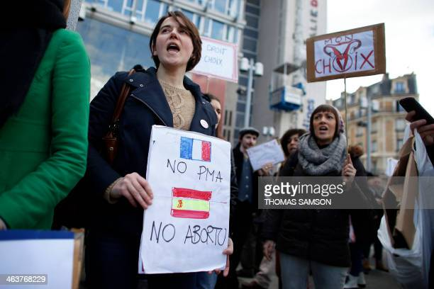 Women hold placards reading 'No PMA No Abortion' and 'My choice' as they demonstrate to defend abortion rights in Paris on January 19 2014 Between...