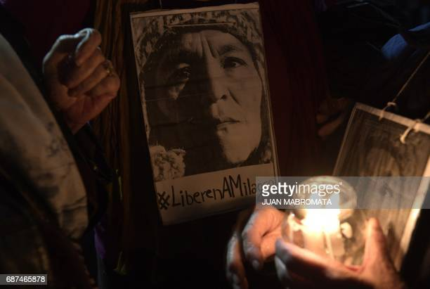 Women hold portraits during a march with torches demanding the release of the leader of the Tupac Amaru neighbourhood association activist Milagro...