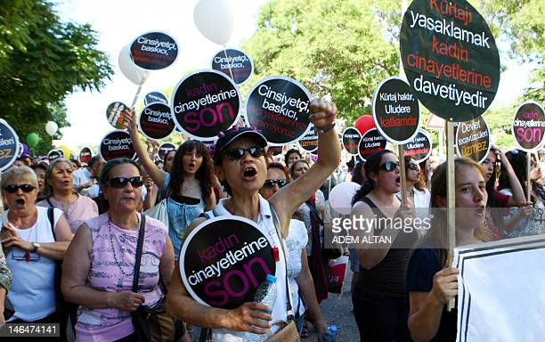 Women hold signs as they take part in a demonstration against government plans to ban or limit the practice of abortion in Turkey on June 17 in...