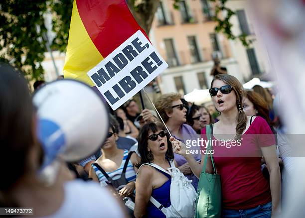 Women hold signs as they take part in a protest against a reform of the country's abortion law recently proposed by the conservative Spanish...