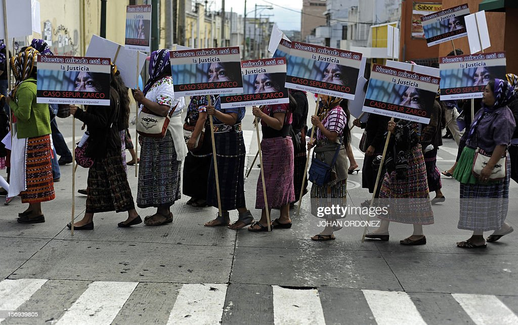 Women hold signs in allusion to the Sepur Zarco case --a military base where sexual slavery took place during the country's armed conflict (19882-88)-- during a demonstration to commemorate the International Day for the Elimination of Violence Against Women, in Guatemala City on November 25, 2012. So far this year, 532 women have died due to violent events in Guatemala. AFP PHOTO/Johan ORDONEZ