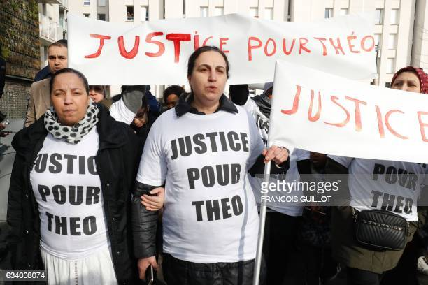 Women hold signs reading 'Justice for Theo' during a protest on February 6 2017 in AulnaysousBois northern Paris a day after a French police officer...