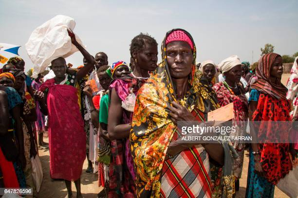 Women hold their registration cards as they queue to get food during a distribution on March 4 in Ganyiel Panyijiar county in South Sudan South Sudan...