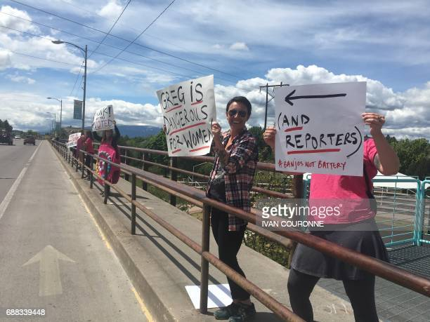 Women hold up signs as people vote in a special Congressional election on May 25 2017 in Missoula Montana The top Republican in the US Congress...