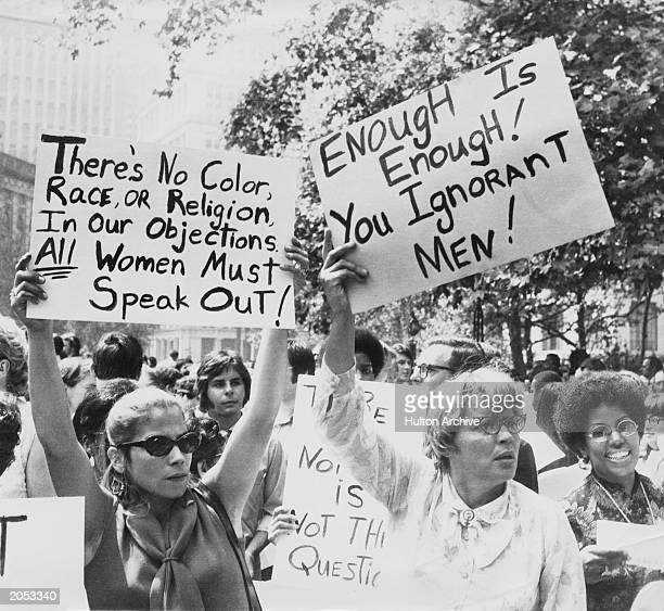 Women hold up signs demanding equal rights during a demonstration for women's liberation New York City circa 1968