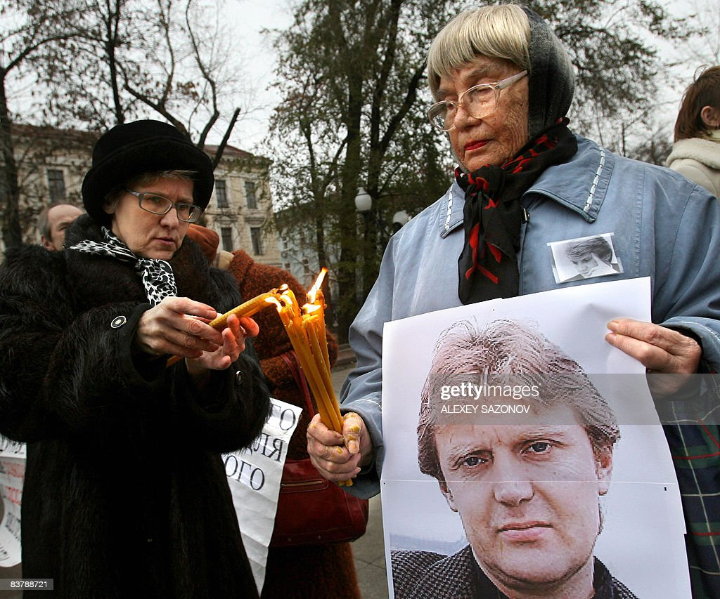 Women holding a poster of deceased former Russian spy <a gi-track='captionPersonalityLinkClicked' href=/galleries/search?phrase=Alexander+Litvinenko&family=editorial&specificpeople=2926201 ng-click='$event.stopPropagation()'>Alexander Litvinenko</a> light candles in his honor in Moscow on November 22, 2008. The man accused of murdering Litvinenko in London said in a British newspaper that he was prepared to come to Britain to be questioned about the case. Andrei Lugovoi, a Russian lawmaker and an ex-KGB agent, told The Times that he was considering sending his friend, Dmitry Kovtun, who was one of the last people to meet Litvinenko before he fell ill, to meet detectives.
