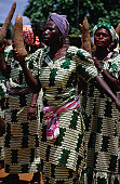 Women holding yams in procession for Igname (yam) festival.