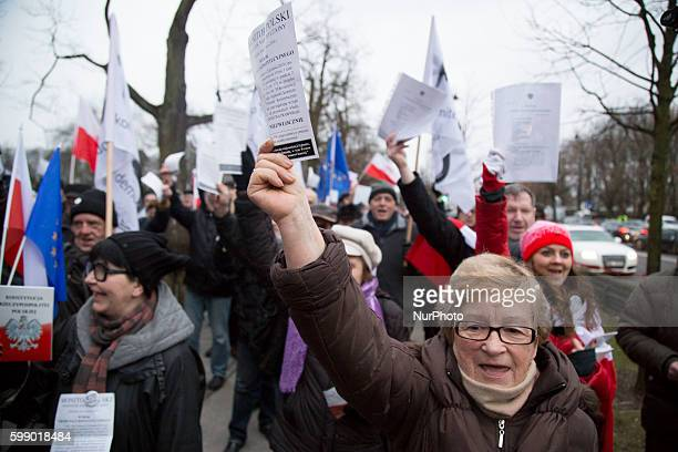 Women holds copy of verdict pronounced by Constitutional Tribunal during antigovernment demonstration in Warsaw on March 10 2016