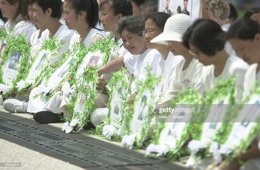 Women honoring the Chinese killed by the communist government for practicing Falun Gong.