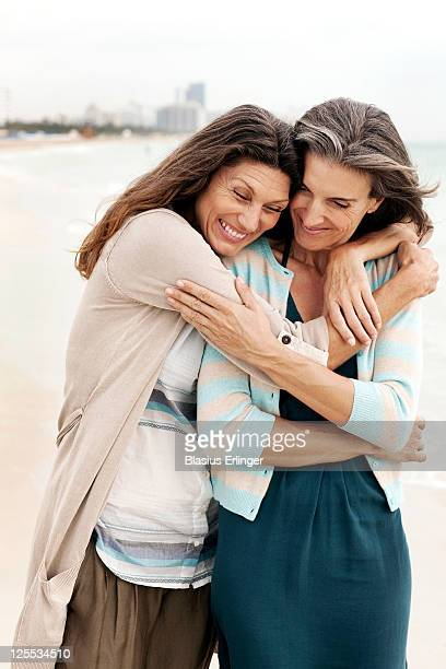 Women Hugging On Beach