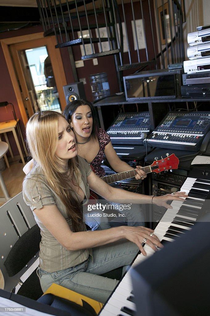 Women in a recording studio : Stock Photo