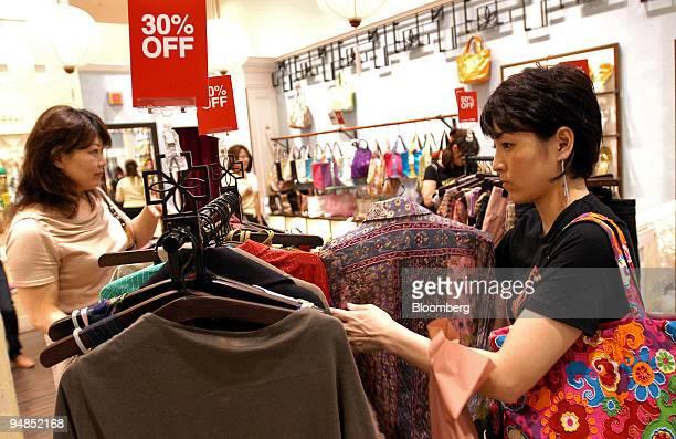 Women in a Takashimaya department store in Nagoya shop for clothing Monday July 11 2005