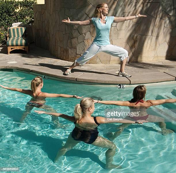 Women in an aquatic yoga class