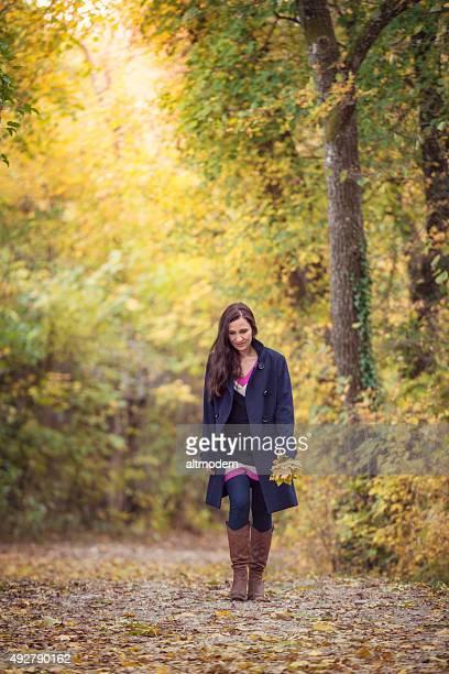 women in autumn forest