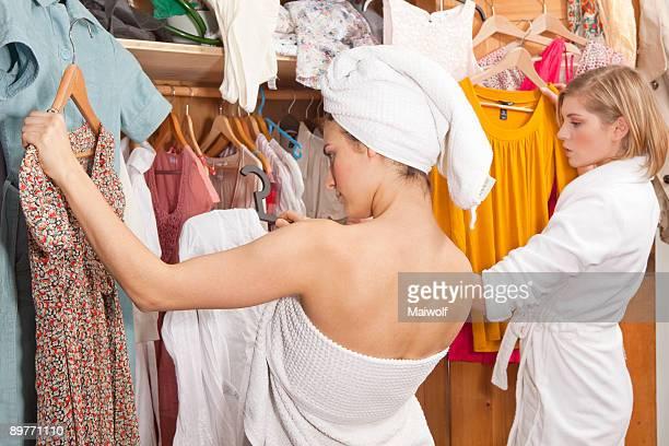 Women in bathrobes in front of closet