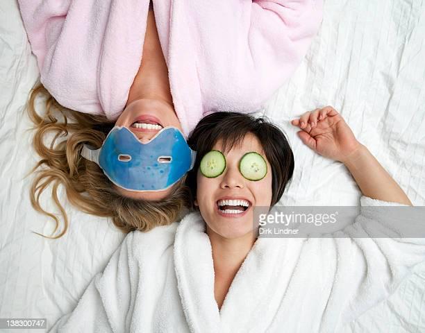 Women in bathrobes wearing eye masks