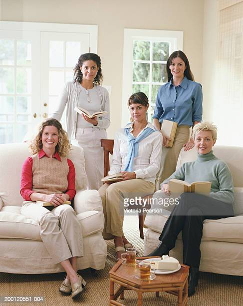 Women in book club sitting in living room, portrait