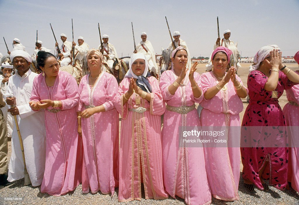 Women in bright dresses participate in a celebration for the wedding of Princess Lalla Asmaa, daughter of Hassan II, King of Morocco.