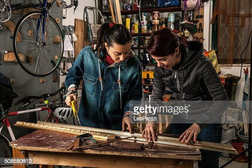 Women in business, working in a garage : Stock Photo
