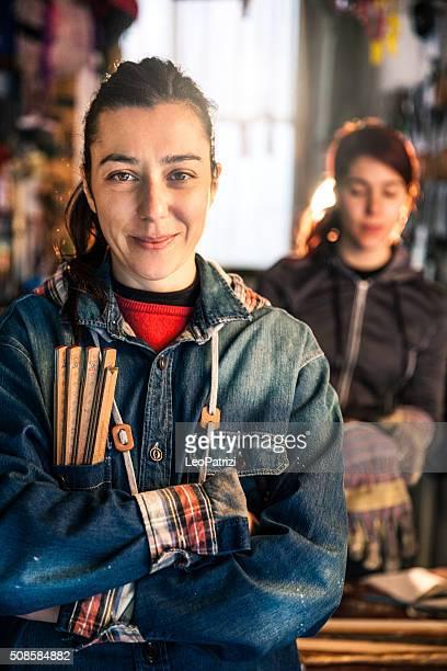 Women in business, working in a garage