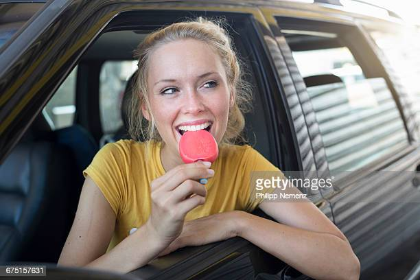 women in car with ice
