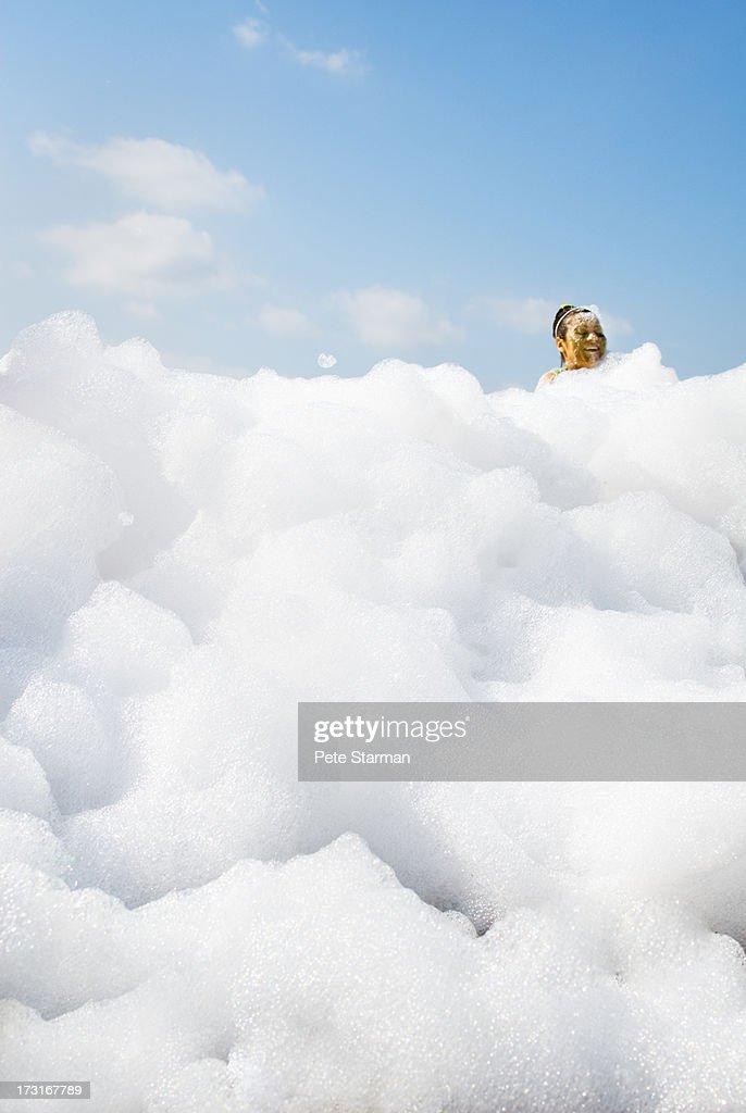 Women in detergent foam at Mud Run.