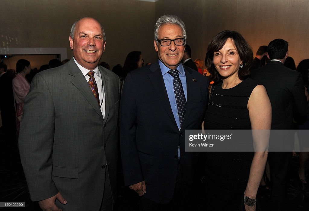 Women in Film CFO Bill Harris, Academy of Motion Picture Arts and Sciences President <a gi-track='captionPersonalityLinkClicked' href=/galleries/search?phrase=Hawk+Koch&family=editorial&specificpeople=627910 ng-click='$event.stopPropagation()'>Hawk Koch</a> and Women in Film board member Orly Adelson attend Women In Film's 2013 Crystal + Lucy Awards at The Beverly Hilton Hotel on June 12, 2013 in Beverly Hills, California.